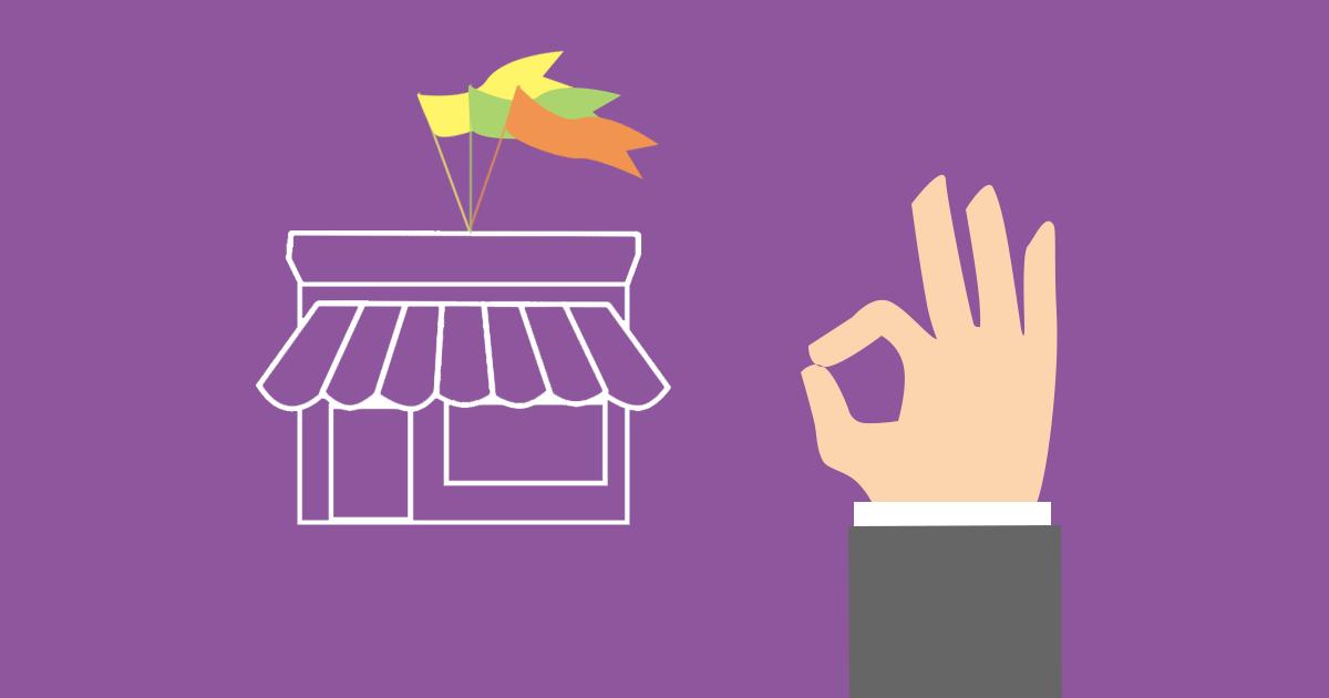 En positiv handrörelse framför en webbutik för att illustrera hur du lyckas med din e-handel.